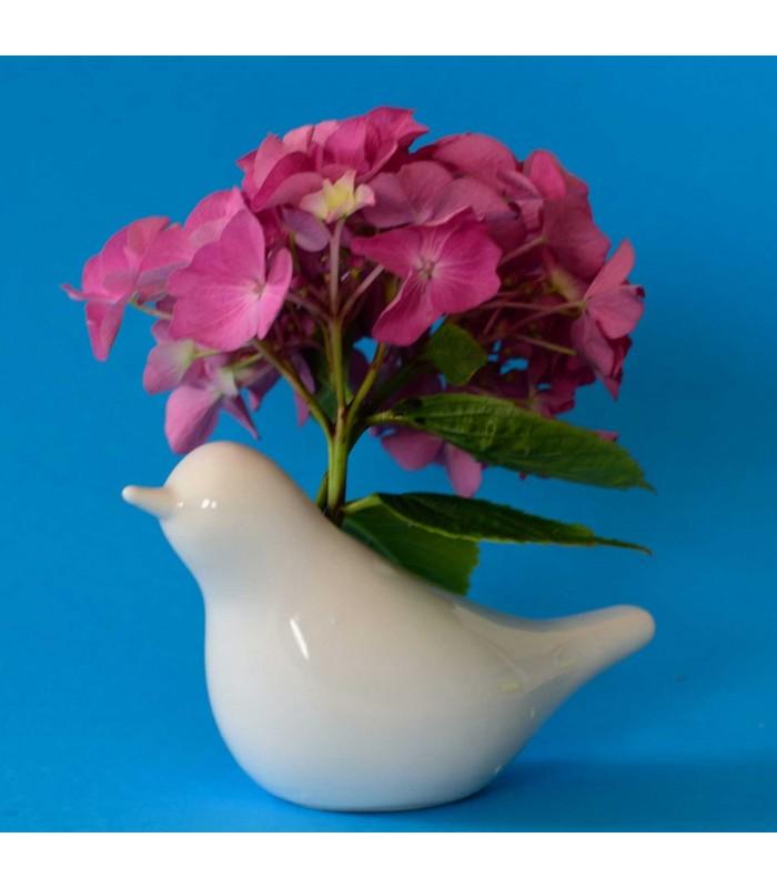 Vase en porcelaine blanche forme oiseau